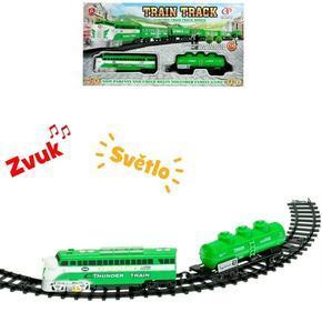 Vlak s vagónem a dráhou Tom